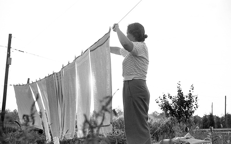 Bringing in the laundry from the line in 1953